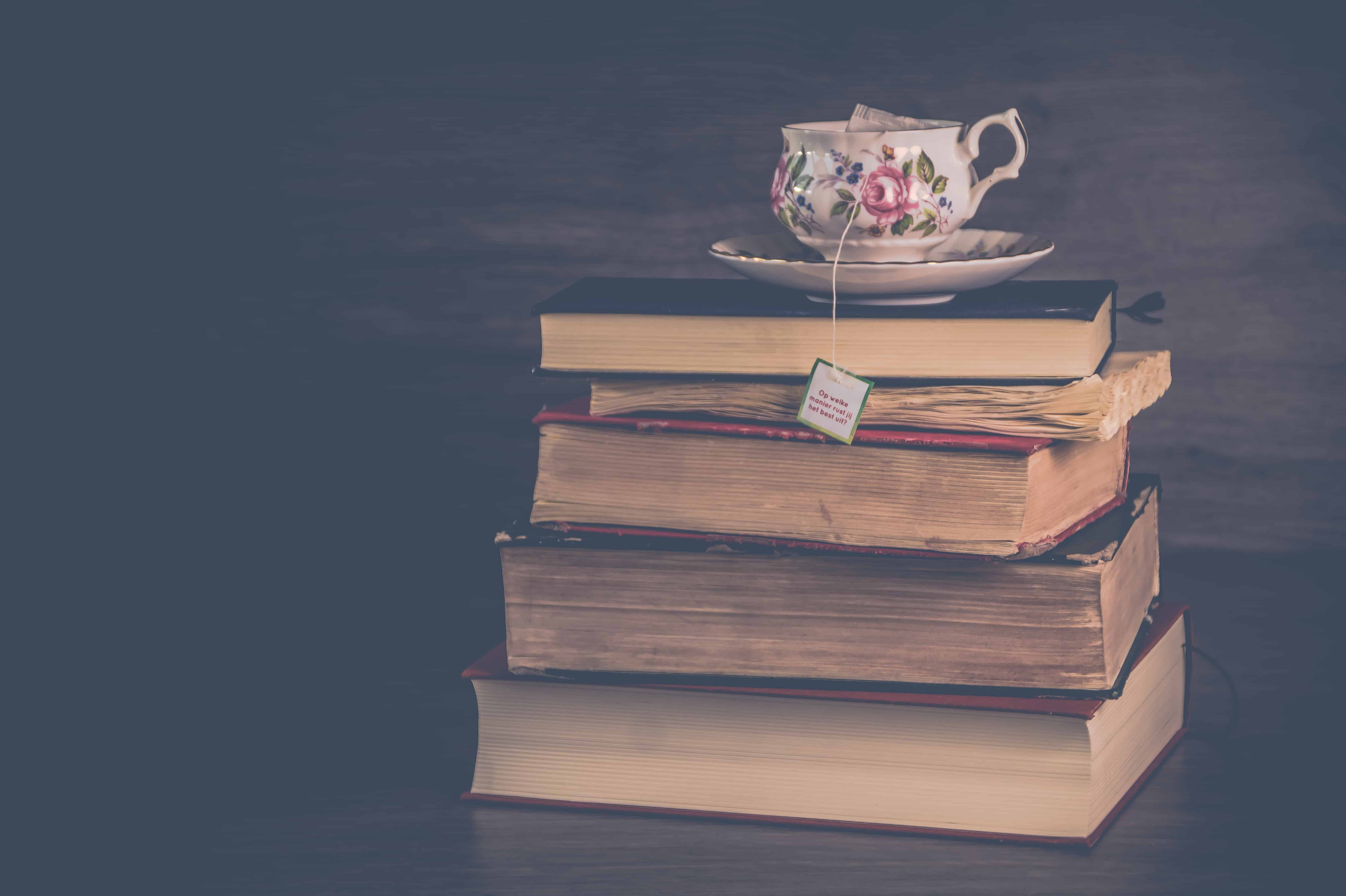 Cup of tea sitting on old books