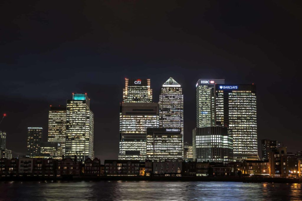 skyscrapers of canary wharf in london at night