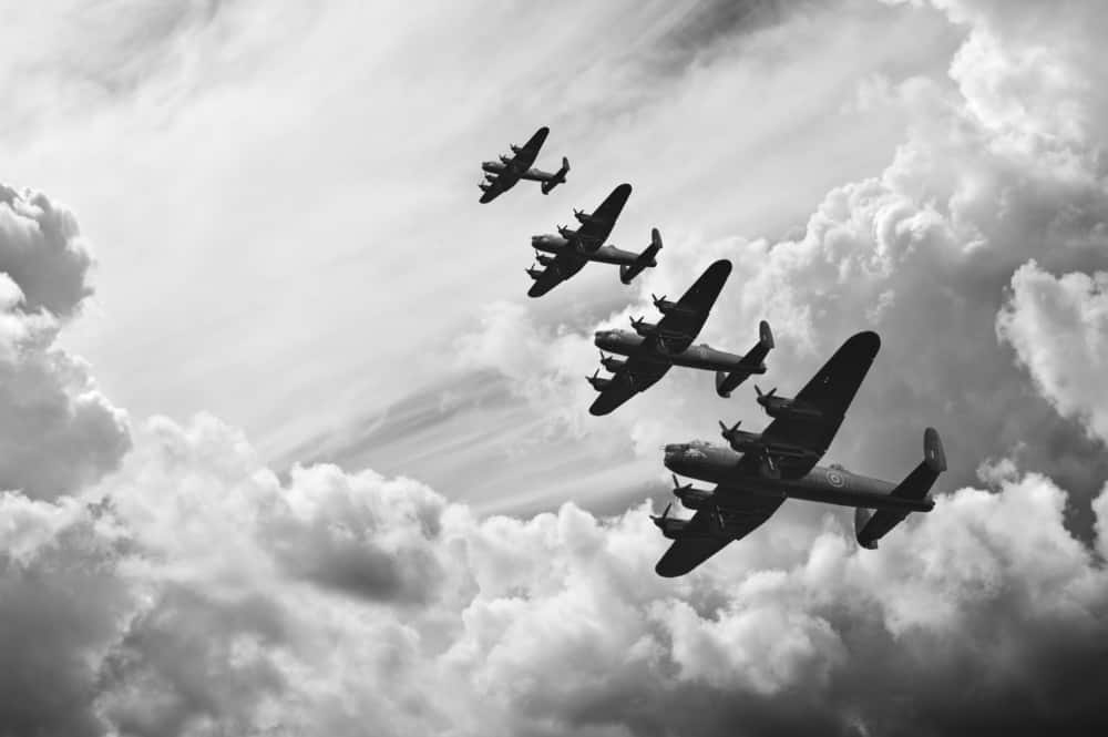 lancaster bombers flying through the sky in formation during the battle of britain